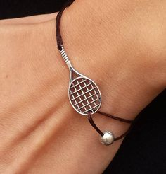 Cord bracelet with sterling silver tennis racket and tennis ball charms Tennis is a bracelet for tennis lovers. A cool gift for a friend who is in love with this game or a tennis-player. Mode Tennis, Sport Tennis, Tennis Tips, Tennis Wear, Tennis Match, Play Tennis, Tennis Outfits, Tennis Clothes, Tennis Shirts