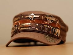 Steampunk hat by yukosteel on DeviantArt Steampunk hat by yukosteel - DIY inspiration: Embellish a plain cap with leather strips, wire, gears, rivets. Great for everyday steampunk wear! Steampunk Cosplay, Viktorianischer Steampunk, Steampunk Crafts, Steampunk Design, Steampunk Clothing, Steampunk Fashion, Steampunk Mechanic, Steampunk Necklace, Steampunk Images