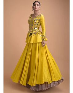 This Mustard Yellow Peplum top enhancd in full mirror work. Truly make it indo fusion look with umbrella skirt. Product Detail: Product Type: Lehenga Neckline: Deep V Sleeve Length: Full Sleeves Fabric: Silk Color: Mustard Yellow Work: Mirrorwork Indian Fashion Dresses, Indian Gowns Dresses, Dress Indian Style, Indian Designer Outfits, Indian Outfits, Designer Clothing, Indian Wear, Bridal Dresses, Silk Saree Blouse Designs