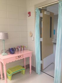 Curtains hanging from a tension rod in the doorway makes for a cozy entrance.