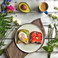 Toasted Genius brown bread with goat cheese, avocado, a poached egg, chili flakes and Himalayan pink salt. And a slice of toasted Genius Fruit loaf with goat cheese, strawberries, blueberries and an edible flower.