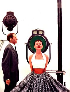 Audrey Hepburn (wearing 'Simplicity Pattern') photographed with her then husband the actor and director Mel Ferrer for a fashion editorial for Seventeen Magazine (July 1954). Photo by Richard Avedon.