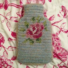 Crochet and cross-stitch hot water bottle cover made by Abi on Not What Your Nana Made