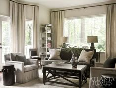 """The study almost looks like a black-and-white photo, it's so monochromatic,"" says Webb. Comfort and durability are key for the sofa and chairs, which are available at Bungalow Classic. Simple panel draperies from Restoration Hardware and pillows from Scott Antique Markets soften the room."