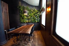 Taking green design to a veritably literal level, Atera's living wall is both a statement piece and a decorative component at the newly opened restaurant in NYC's Tribeca neighborhood.