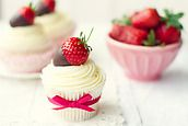 Cupcakes decorated with chocolate-dipped strawberries by Ruth Black - Stocksy United - Royalty-Free Stock Photos