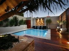 Indoor pool design using timber with decking & decorative lighting -