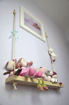 Cute idea for playroom or kids bedroom - decorative swing on the wall