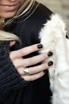 short. round. black nails. bold silver ring.