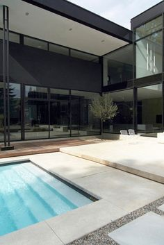 Pool area of the Belvedere residence in Oakville, Canada, by Guido Costantino Design Office.  This modern, cutting edge design home was built with Bigfoot Door's windows, doors, sidings and curtain walls.