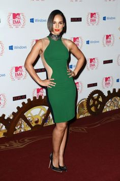Alicia Keys: form-fitting dresses with leather detailing, dramatic red lips, a chic bob