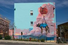 """Dog get rescued by a cat ballon"" Setúbal, Portugal: new piece by Bane&Pest for CARA OU COROA Street Art Festival."