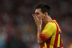 Lionel Messi of FC Barcelona reacts as he fails to score during the Spanish Super Cup first leg match between Club Atletico de Madrid and FC Barcelona at Vicente Calderon Stadium on August 21, 2013 in Madrid, Spain.