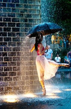 I want to dance in the rain like this girl, but I don't know ballet.