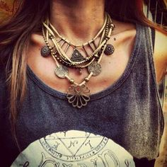 Layered edgy-boho bronze neckwear.