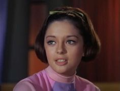 """Penny Robinson (Angela Cartwright): The middle child,13-year-old in Season 1, she loves animals and classical music. Later in the series, she acquires a chimpanzee-like alien pet with pointy ears that made one sound, """"Bloop"""". While it is sometimes remembered by that name,[1] Penny named the creature """"Debbie."""" Most of Penny's adventures have a fairy-tale quality, underscoring her innocence. She is described in the pilot, """"No Place To Hide"""", as having an IQ of 147 and an interest in zoology."""