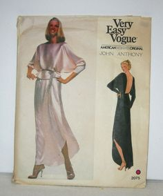 Vogue 2075 Designer Backless Evening Gown (2 piece) Sewing Pattern ~ Uncut:  Misses Evening Top and Skirt. Very loose-fit blouson top has front, back & sleeves cut-in-one. The top has a shaped front hemline extending below waist, with a waistband & narrow hem or zigzag finish. Long dolman sleeves are worn pushed up. Purchased belt. Evening length, front wrapped slightly gathered skirt has shaped hemline, waistband & narrow hem or zigzag finish.  Misses Size 10 Bust 32.5 Waist 25 H...
