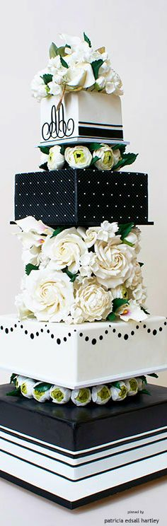 If we get a cake... how about black icing all around like the second tier with gold writing and a green mask? Definitely not tiered though.. one rectangular cake.