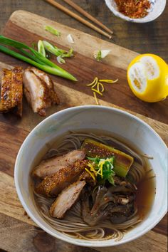 CHICKEN SOBA NOODLE SOUP This hearty noodle soup is good for any day in winter. It is very satisfying dish with pan seared chicken, charred leeks, and sake steamed mushrooms.
