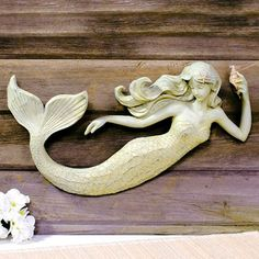 Painted polyresin mermaid figurine carved to look like wood mounts to any flat surface. Built-in mounting. Aged finish for a completely beachy, vintage look. Dimensions: H x W x D Shipping weight: 4 lbs. Mermaid Bathroom, Mermaid Room, Mermaid Sculpture, Mermaid Fairy, Mermaid Dolls, Mermaid Crafts, Mermaids And Mermen, Merfolk, Paperclay
