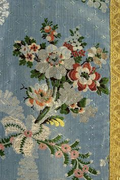 Detail of chasuble made from blue silk gros de tour brocaded in a floral and serpentine pattern trimmed with gold ribbon, French, textile probably from Lyon, ca. 1765, KSUM 1986.123.45 ab.