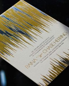 Urban chic meets golden glam in this letterpress invitation