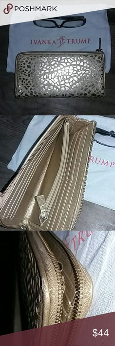 """IVANKA TRUMP gold laser cut wallet/clutch COMES WITH DUST BAG  laser cut gold over shiny goldpeeking out..zip afound wallet 8.5X4.5""""  1 center zip pocket..2 full length pockets 12 card pockets...EUC..shows very very light wear on the corners..I assure you I used this less than a month 🙂 Ivanka Trump Bags"""