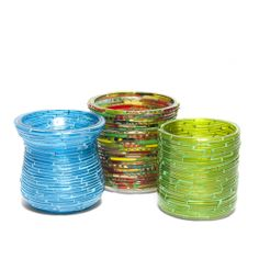 Indian Candle Holders made from Bangles   Use a circle from cardboard and hot glue bangles onto them and then insert a clear glass votive holder.