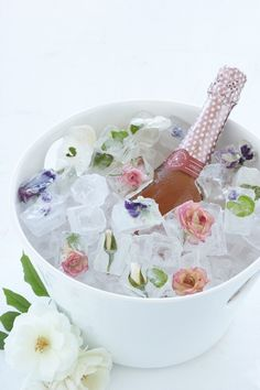 Champagne chilling in a bucket of ice with roses embedded in the cubes, what a lovely gift to have waiting for the Bride and Groom, a Bridal Shower, or a pretty Birthday Party.