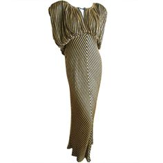 Bob Mackie gold and black beaded Godess dress | From a collection of rare vintage evening dresses at http://www.1stdibs.com/fashion/clothing/evening-dresses/