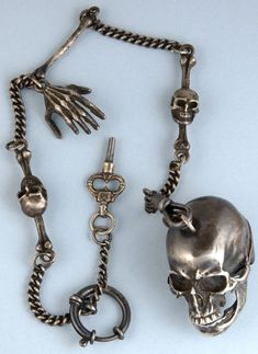 Skulls: 1930s men's watch chain with #skull.