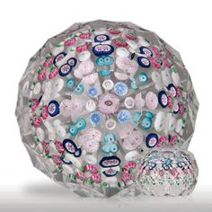 Excellent antique Clichy spaced concentric millefiori magnum honeycomb faceted paperweight.