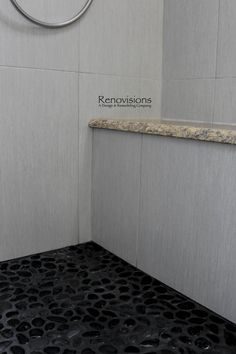 a recently completed master bathroom remodel by renovisions master bath black pebble tile floor
