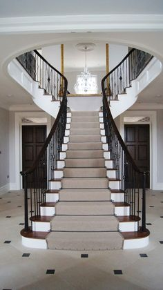 devon grand staircase traditional with banister railing iron chandeliers Luxury Staircase, Grand Staircase, Railing Design, Staircase Design, Staircase Ideas, Stair Design, Wooden Staircases, Stairways, Staircase Runner