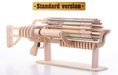 The Coolest Rubber Band Machine Gun - 672 Shots with Fast Charger - Magazine Boulevard (too cool for school) Woodworking Toys, Woodworking Projects, Wood Projects, Projects To Try, Rubber Band Gun, Wood Toys, Diy Toys, Wood Art, Tricks