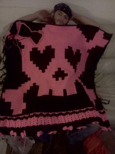 Girl Skull with bows throw I crocheted for my best friend (being sported by the hubby)