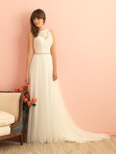 Delicate layers of tulle pair with intricate lace in this romantic halter wedding dress. @allurebridals