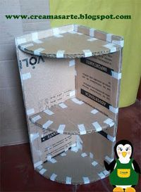 Cardboard can be a very useful tool in constructing simple around-the-house devices. Learn how to take a simple cardboard box that was almost trash and turn it into a functional corner shelf.Resultado de imagem para muebles de carton reciclado paso a Diy Cardboard Furniture, Cardboard Crafts, Paper Crafts, Diy Furniture, Cardboard Storage, Cardboard Kitchen, Cardboard Organizer, Cardboard Letters, Cardboard Boxes