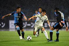 edf5eebf4fc Kyogo Furuhashi of Vissel Kobe and Tatsuki Nara of Kawasaki Frontale  compete for the ball during