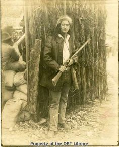 An unidentified actor portraying David Crockett in front of the reconstructed Alamo palisade. Mexican American War, Native American Art, American History, Alamo Movie, San Antonio, Texas Forever, The Siege, Texas History, Silent Film