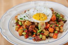 Roasted Sweet Potato Hash with shallots, chilis, edamame, bacon, fried duck egg via @DragonRanch in Chicago.
