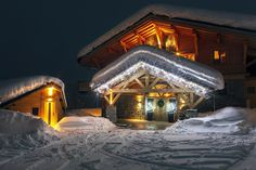 Brilliantly lit exterior of the luxurious Grande Corniche with snow-covered landscape around it