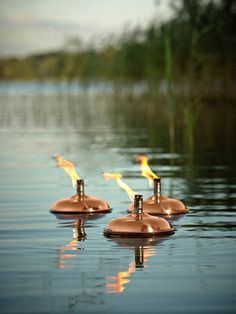 Copper floating oil lamps - with anchor to hold them in place! Great for #weddings & parties