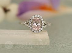 Pretty in pink! Ring shown: Pink Champagne Sapphire Split Shank Diamond Halo. Gemstone Engagement Rings, Halo Diamond Engagement Ring, Morganite Engagement, Diamond Rings, Gold Rings, Peach Sapphire, Natural Sapphire, Sapphire Diamond, Engagement Ring Buying Guide