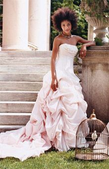 """Mori Lee by Madeline Gardner Embroidery on the Empire bodice and meticulous pick-up draping make this gown a standout. """"The concept of our blush pink gown was to express the true femininity of a confidant woman who believes that the color will add glow to her beauty on her wedding day,"""" says Madeline Gardner. Price: $749, Mori Lee by Madeline Gardner."""