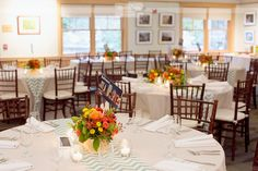 Great photo of the wedding reception tables set up at the McLane Center at the Audubon Society on Silk Farm Rd. in Concord, NH.  The ceremony was held at St. Paul's School in Concord, NH in October!  #rusticreception #audubonreception #dreamlovephotography #nhwedding
