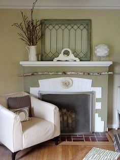 Antique stained glass window over fireplace