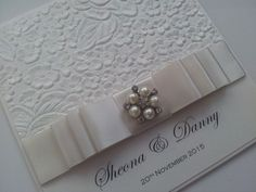 The Ivy Collection, another stunning wedding invitation, we used a floral embossed paper, with a triple formal bow using ivory pearl satin ribbon, finished with a pearl and crystal embellishment.