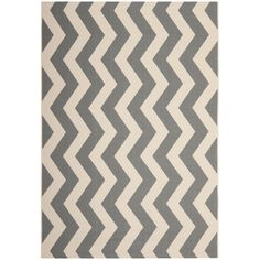 Add a touch of style to your space with this zig-zag indoor/outdoor rug from Safavieh. Featuring a power-loomed design that will withstand sun, water, mold and mildew, this rug will give your deck, patio, or backyard an extra touch of class.