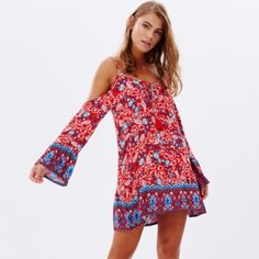 NWT UO MINKPINK Boho Cold Shoulder Dress NWTSize SBoho Dress from URBAN OUTFITTERSCold Shoulder Dress by MINKPINK features a floral paisley print in contrasting blue and red hues. The cut-out shoulder design and flared sleeves complete the lookAdorable and VersatileRetails $89  - Length: 80cm - Regular fit - Lightweight crepe  - Adjustable shoulder straps - Flared sleeves - Tie fastening on the chest  Material: 60% Viscose, 20% Polyester & 20% Lyocell Urban Outfitters Dresses Mini